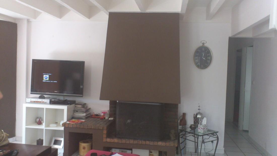 Réaménagement d'un séjour et création d'une cheminée sur mesure