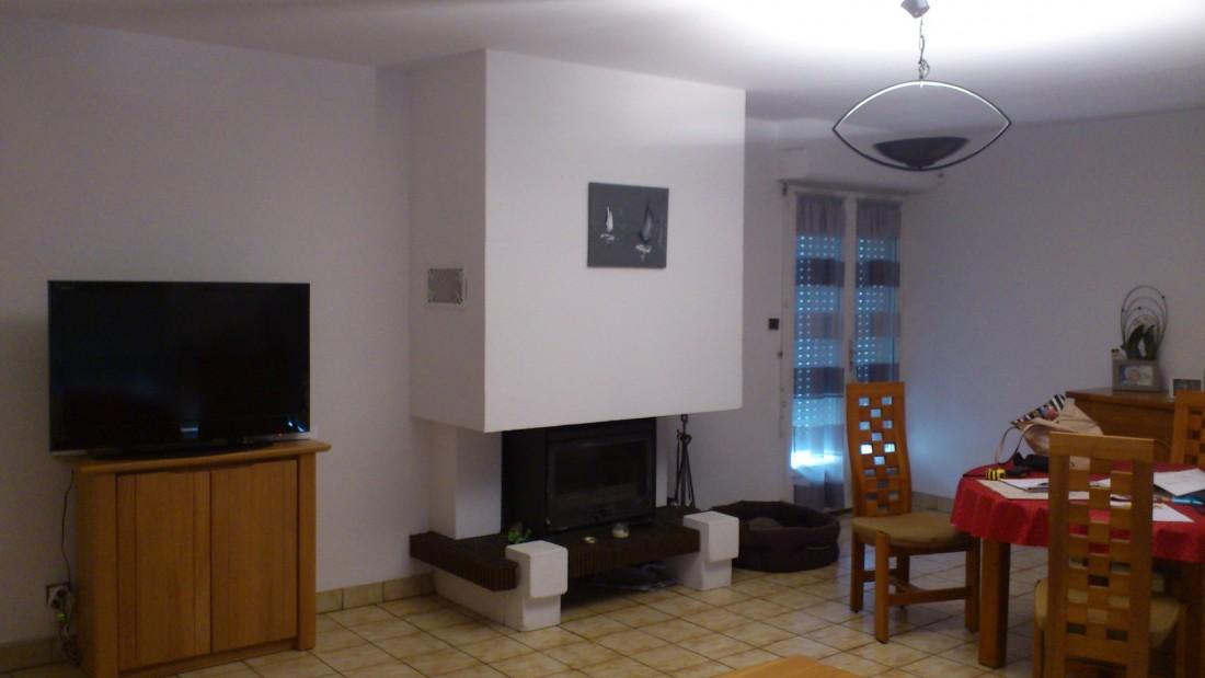 Réaménager une pièce de vie avec une cheminée vers Bordeaux